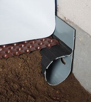 Closeup of a crawl space drainage system installed in Edwards
