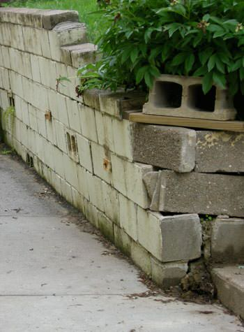 collapsing retaining wall with severe damage in Manotick