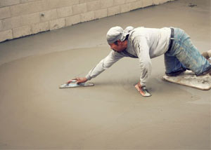 smoothing out the grout in a slab releveling project in Smiths Falls