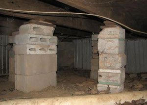 crawl space repairs done with concrete cinder blocks and wood shims in a Prescott home