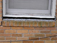 A window sill cracking and separating from the foundation wall in a Kemptville home.