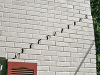 Stair-step cracks showing in a home foundation in Elizabethtown