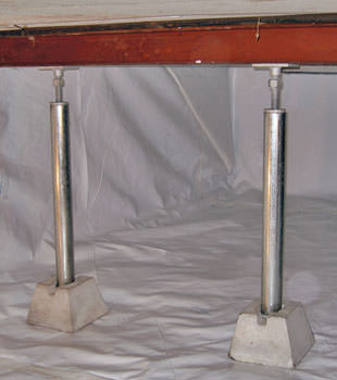 Crawl space jack posts installed in conjunction with a crawl space vapor barrier in Edwards
