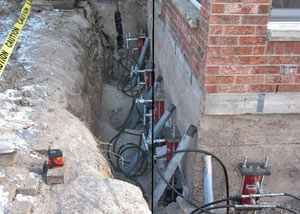 Foundation push piers installed around a house with a foundation settlement issues in Edwards
