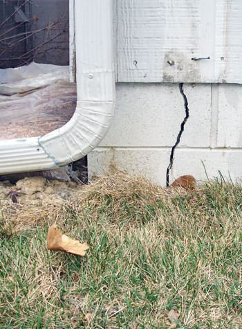 foundation wall cracks due to street creep in Russell