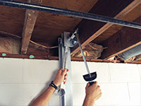 Straightening a foundation wall with the PowerBrace™ i-beam system in a Renfrew home.