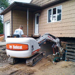 Excavating to expose the foundation walls and footings for a replacement job in Perth