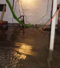 A basement flood can lead to extensive damage to finishing materials and stored items.