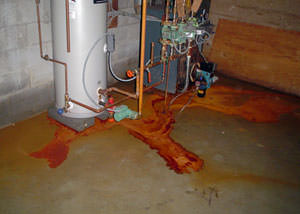 Iron ochre water on a concrete basement floor, staining everything